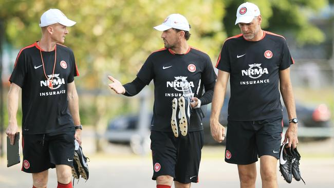 Coach, Tony Popovic, c, arrives for training with assistants Hayden Foxe and Zeljko Kalac at Western Sydney