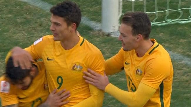The Olyroos celebrate a goal.