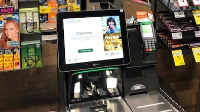 The cameras overlook customers using the self-serve checkout.