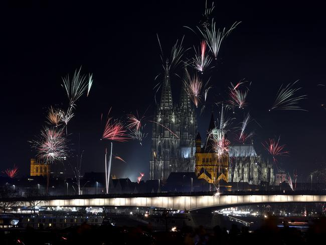Scene of mass sex attack ... Fireworks explode over the river Rhine in front of the Great Saint Martin Church and the Cologne Cathedral during New Year's celebrations in Cologne.