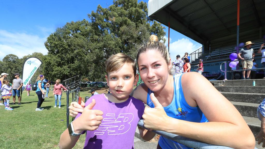 """12th September 2020, Ashmore Gold Coast, Riordan """"Rio"""" Harris is an 11 year old member of Ashmore Little Athletics has been diagnosed with an aggressive brain tumour (which cannot be removed) Ashmore Little Athletics have been fundraising for the family with ÔRun for Rio' L-R, Riordan ÒRIOÓ Harris and Coach Nicole Gusman Photo: Scott Powick News Corp"""