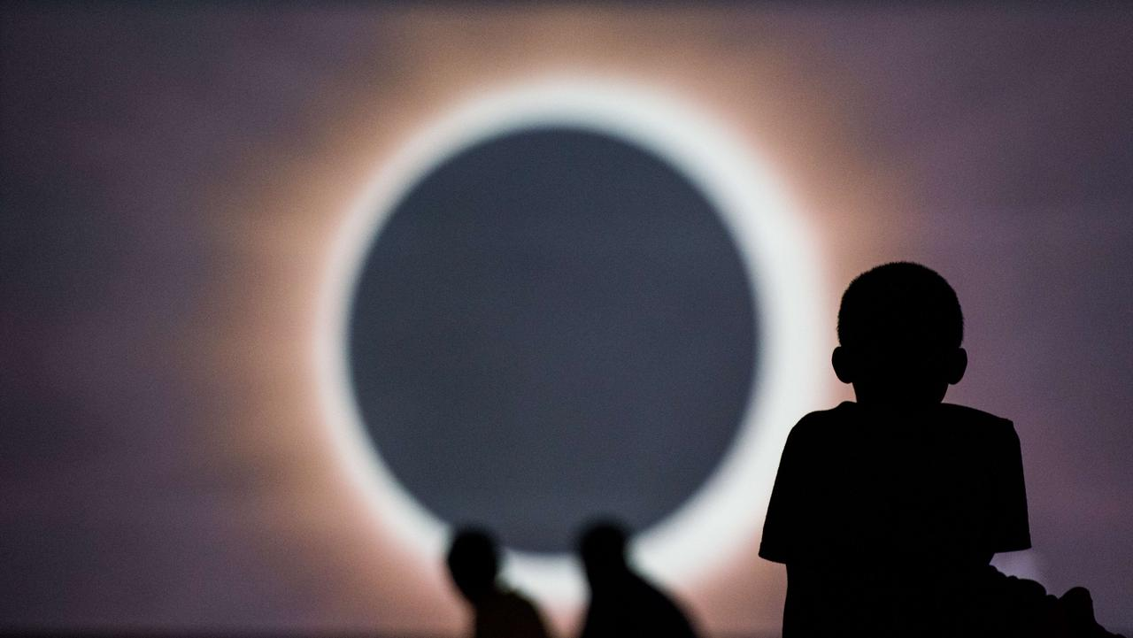 Children watch a presentation about the eclipse at the Historic Columbia Speedway. Picture: Sean Rayford/Getty Images/AFP
