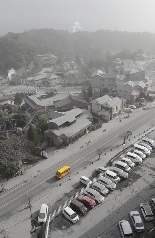 Cars and buildings are covered with volcanic ash after Mount Shinmoedake erupted, in Kirishima city, 6 kilometres from it. Picture: AP