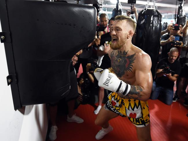 Conor McGregor hits an uppercut bag during a media workout.