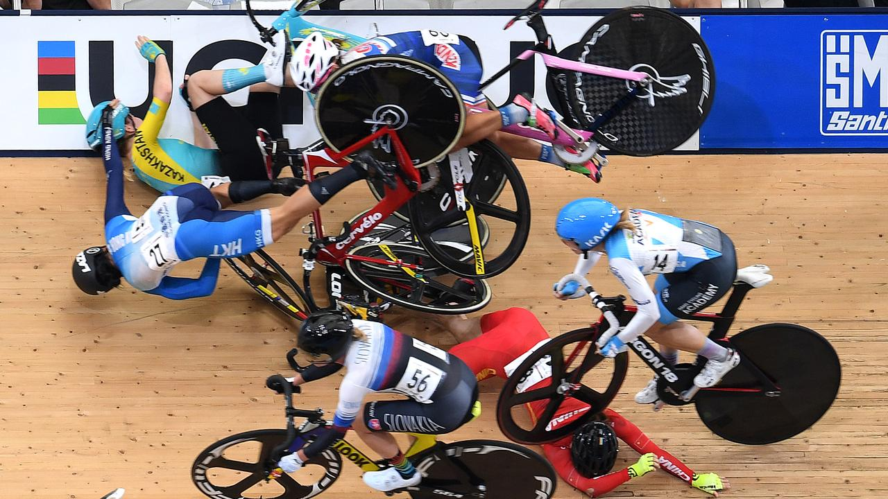 Riders crash during the women's Omnium Scratch race at the Tissot UCI Track Cycling World Cup at the Anna Meares Velodrome in Brisbane. (AAP Image/Dan Peled)