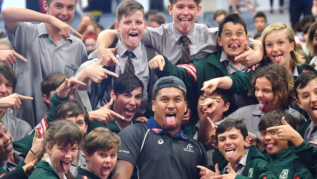 New Wallaby Brandon Paenga-Amosa with students at Kelvin Grove State College.