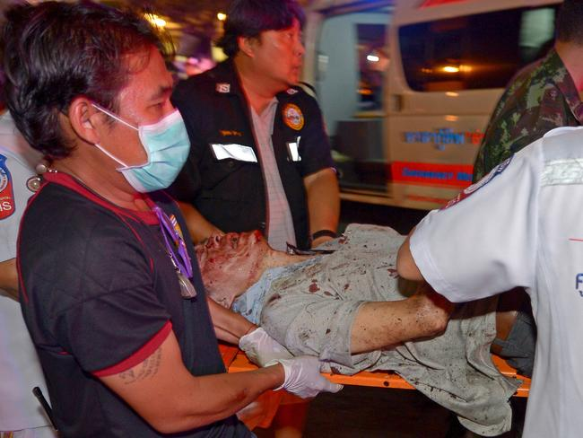 Injuries ... Thai rescue workers transport an injured person to a waiting ambulance. Picture: AFP/Pornchai Kittiwongsakul