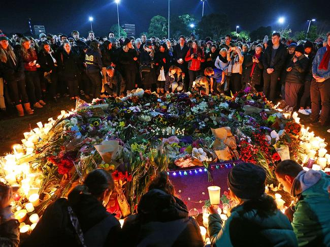 Mourners pay their respects during a vigil held in memory of murdered Melbourne comedian, 22-year-old Eurydice Dixon. Picture: Michael Dodge/Getty Images
