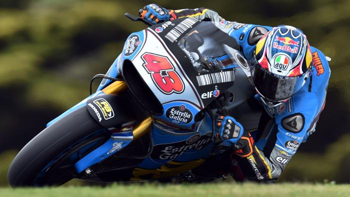 EG 0,0 Marc VDS' rider Jack Miller of Australia powers his machine during the second practice session of the Australian MotoGP Grand Prix at Phillip Island on October 20, 2017. / AFP PHOTO / PAUL CROCK / IMAGE RESTRICTED TO EDITORIAL USE - STRICTLY NO COMMERCIAL USE