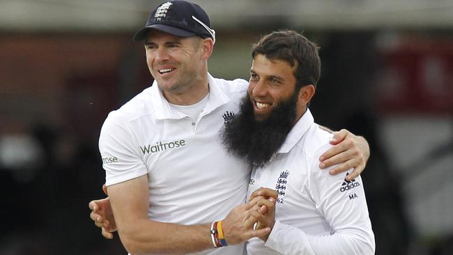 England's Moeen Ali (R) celebrates taking the wicket of Sri Lanka's Kumar Sangakkara for 147 runs with England's James Anderson (L) during the third day of the first cricket Test match between England and Sri Lanka at Lord's.