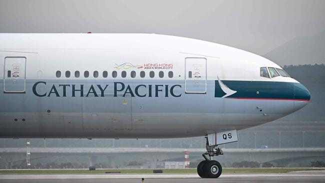 Hong Kong's flag carrier Cathay Pacific has flown headlong into a political storm thrown up by the city's swirling pro-democracy protests, as Beijing turns the screws on any company deemed sympathetic to the movement. Picture: Anthony Wallace/AFP