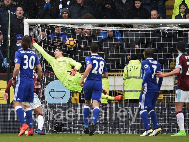 Thibaut Courtois cannot prevent Robbie Brady's freekick making the score 1-1.