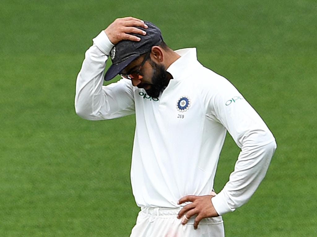 Indian captain Virat Kohli reacts  on day five of the first Test match between Australia and India at the Adelaide Oval in Adelaide, Monday, December 10, 2018. (AAP Image/Dave Hunt) NO ARCHIVING, EDITORIAL USE ONLY, IMAGES TO BE USED FOR NEWS REPORTING PURPOSES ONLY, NO COMMERCIAL USE WHATSOEVER, NO USE IN BOOKS WITHOUT PRIOR WRITTEN CONSENT FROM AAP