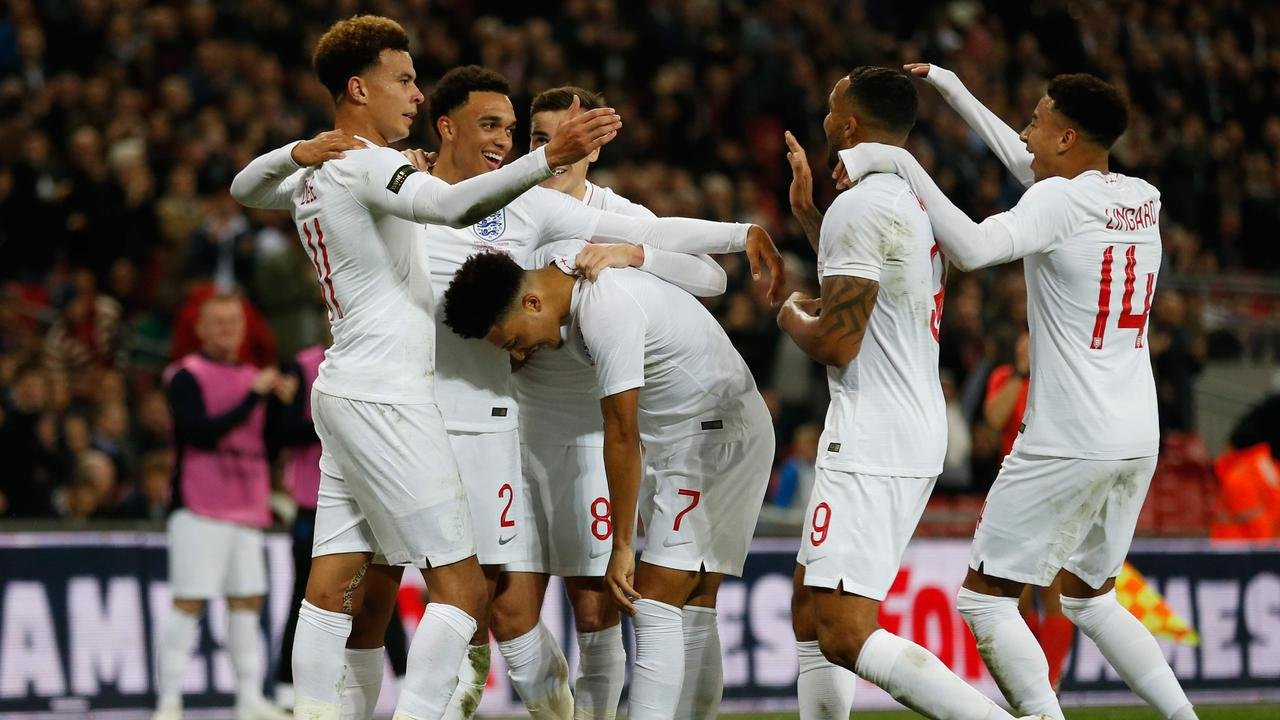England players celebrate the goal together.