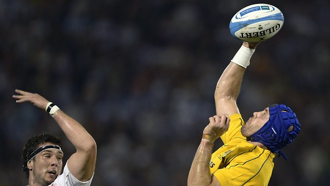 Australian Wallabies' lock Nathan Sharpe, right, reaches for the lineout ball against Argentinian Los Pumas' lock Manuel Carizza at Gigante de Arroyito stadium in Rosario. Picture: Juan Mabromata