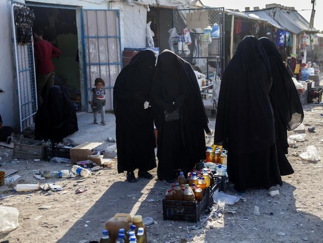 IS brides in Al Hawl camp in Syria where squalor and violence are expected to escalate once Turkish guards leave to fight. Picture: Tessa Fox.
