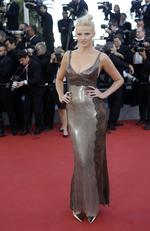 Lara Stone poses for photographers as she arrives for the screening of the film Youth during the 2015 Cannes Film Festival. Picture: AP