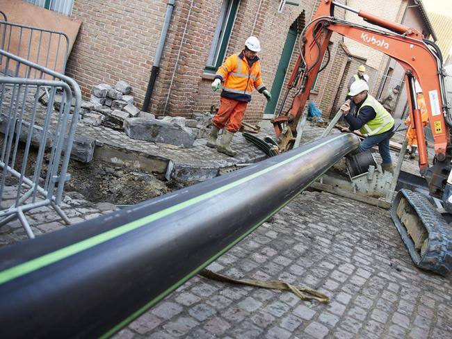 Workers dig the beer pipeline, which will run under the streets of Bruges. Picture: Mahaux