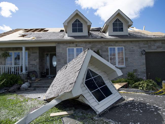 A dormer that was torn from a home's roof by a tornado is seen in Dunrobin, Ontario, Canada west of Ottawa. Picture: Justin Tang/The Canadian Press via AP