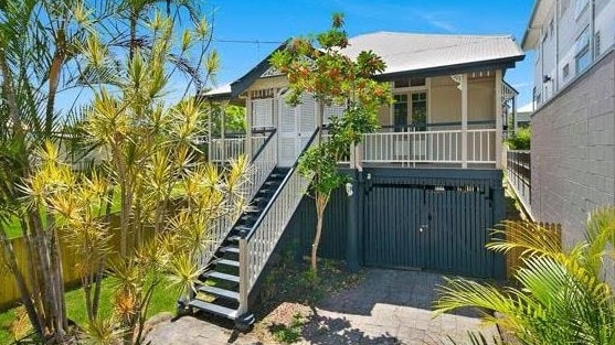 BEFORE: The front of the house at 53 Harrison St, Bulimba, before the renovation.
