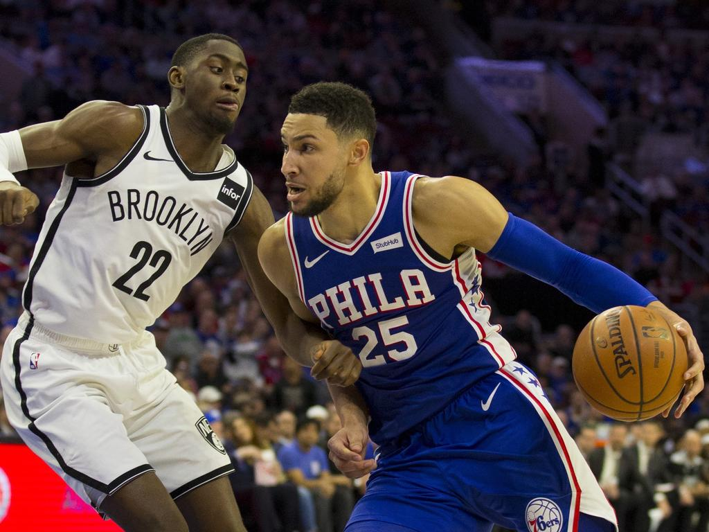 Ben Simmons drives to the basket against Caris LeVert.