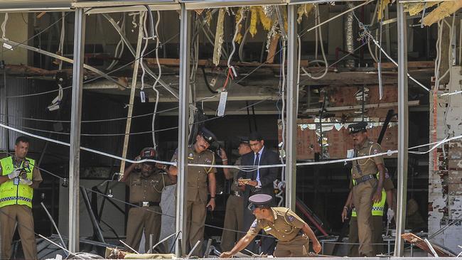 Sri Lankan police inspect the blast spot at the Shangri-la hotel in Colombo. Picture: Chamila Karunarathne
