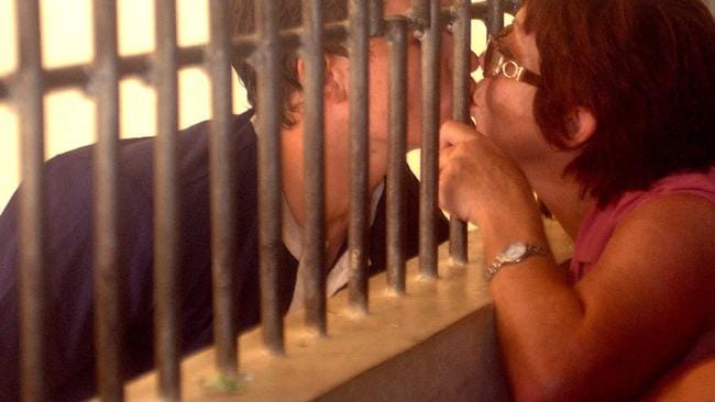 Rush kisses his mother Christine through the bars of the Bali police holding cell. Picture: Mick Tsikas.