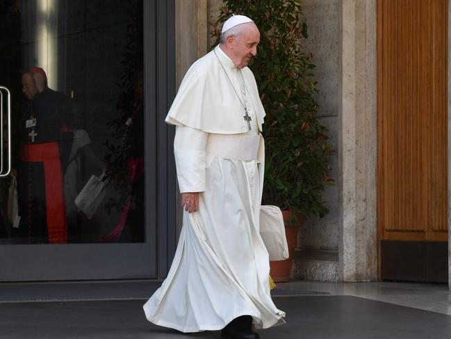 Pope Francis leaves for a lunch break after attending the opening of the Special Assembly of the Synod of Bishops for the Pan-Amazon Region. Picture: AFP