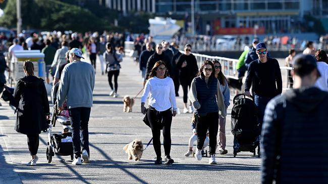 People are seen walking the promenade at Bondi Beach on Saturday morning. Picture: NCA NewsWire/Bianca De Marchi