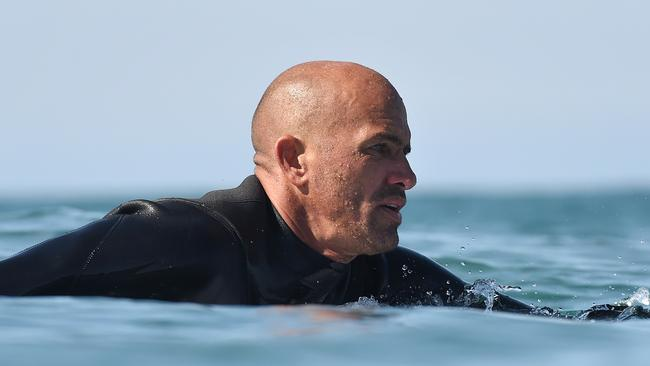 Kelly Slater became a real-life hero after helping rescue a woman and her child were swept away by a wave.