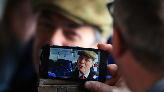 Nigel Farage poses for a photo on the campaign bus. Picture: Lindsey Parnaby/AFP