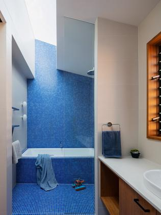 Blue for you: a bathroom is enlivened with bold colour.