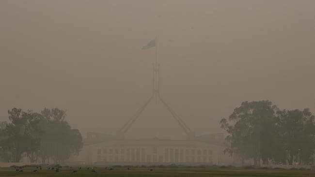 Parliament House was barely visible on New Year's Day. Picture: AAP Image/Lukas Coch