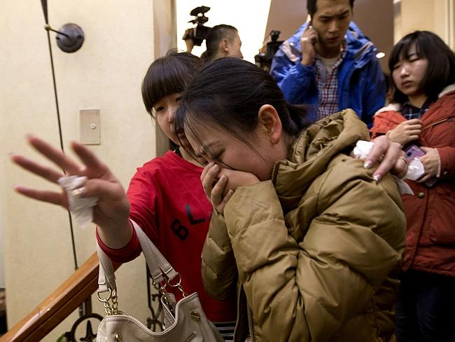 A distraught Chinese relative of passengers aboard a missing Malaysia Airlines plane. Picture: AP
