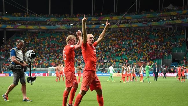Netherlands' forwards Dirk Kuyt and Arjen Robben (R) celebrate.
