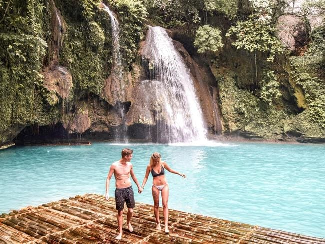 The couple at Kawasan Falls, Philippines.