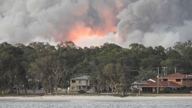 Queensland Fire and Emergency Services say there's no threat to homes, as the Bribie Island bushfires continue to rage.