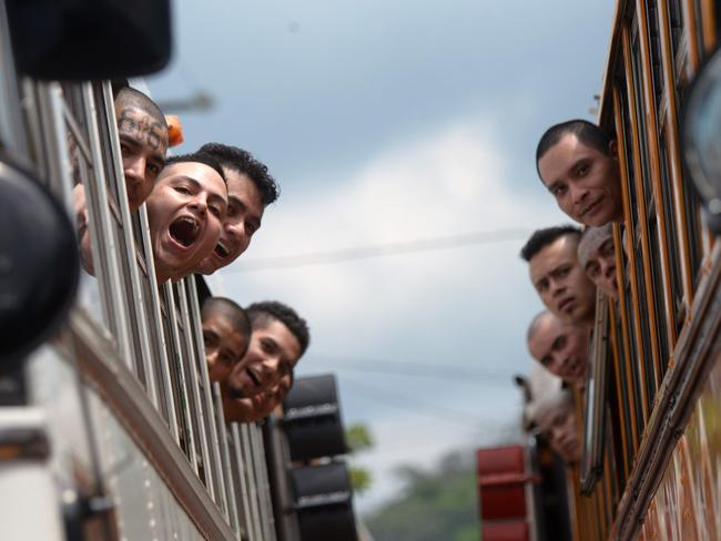 Under heavy security measures, a total of 1282 members were moved to different medium-security prisons after the authorities closed the jail of Cojutepeque due to corruption and bad location. Picture: Marvin Recinos/AFP
