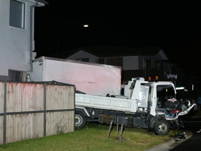 The trucks both smashed into a home after colliding with each other. Picture: Bill Hearne