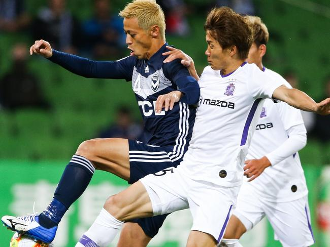 Melbourne Victory's Keisuke Honda (left) controls the ball ahead of Sanfrecce Hiroshima's Sho Inagaki. It was Honda's final match for the club. Picture: AFP