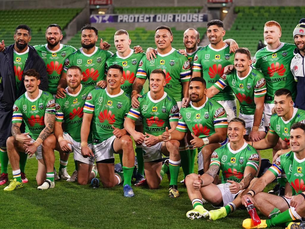 The Raiders pose for a team photo after winning the Round 3 NRL match between the Melbourne Storm and the Canberra Raiders at AAMI Park in Melbourne, Saturday, May 30, 2020. (AAP Image/Scott Barbour) NO ARCHIVING, EDITORIAL USE ONLY