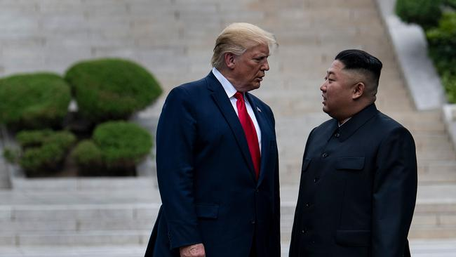 Donald Trump and North Korea's leader Kim Jong-un stand on North Korean soil while walking to South Korea in the Demilitarised Zone on June 30, 2019. Picture: AFP