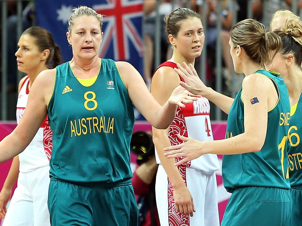 LONDON, ENGLAND - AUGUST 03: Suzy Batkovic #8 of Australia high-fives Kristi Harrower #10 and Belinda Snell #12 after scoring against Russia during the Women's Basketball Preliminary Round match on Day 7 of the London 2012 Olympic Games at Basketball Arena on August 3, 2012 in London, England. (Photo by Christian Petersen/Getty Images)