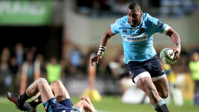 Taqele Naiyaravoro of the Waratahs make a break at Brookvale Oval in Sydney.