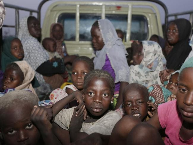 Women and children rescued by Nigeria soldiers from Islamist extremists. AP Photo/Sunday Alamba.