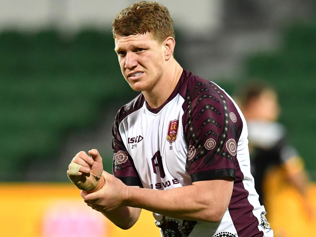 Dylan Napa of the Queensland State of Origin team is seen reacting as he holds his injured wrist during training at HBF Park in Perth, Thursday, June 20, 2019. Queensland are playing New South Wales in the 2nd State of Origin match in Perth on Sunday. (AAP Image/Darren England) NO ARCHIVING