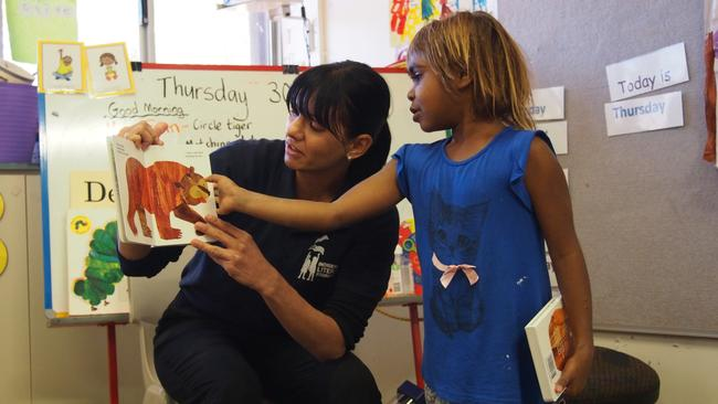 Tina Raye reading to a child. Picture: supplied