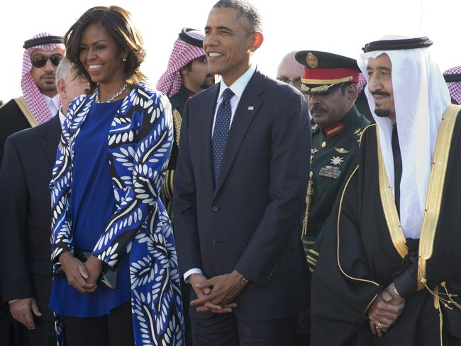 President Barack Obama and first lady Michelle Obama stand with new Saudi King Salman bin Abdul Aziz. Picture: AP Photo/Carolyn Kaster.