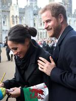 Prince Harry and his fiancee Meghan Markle are seen during a walkabout at Cardiff Castle on January 18, 2018 in Cardiff, Wales. Picture: Getty