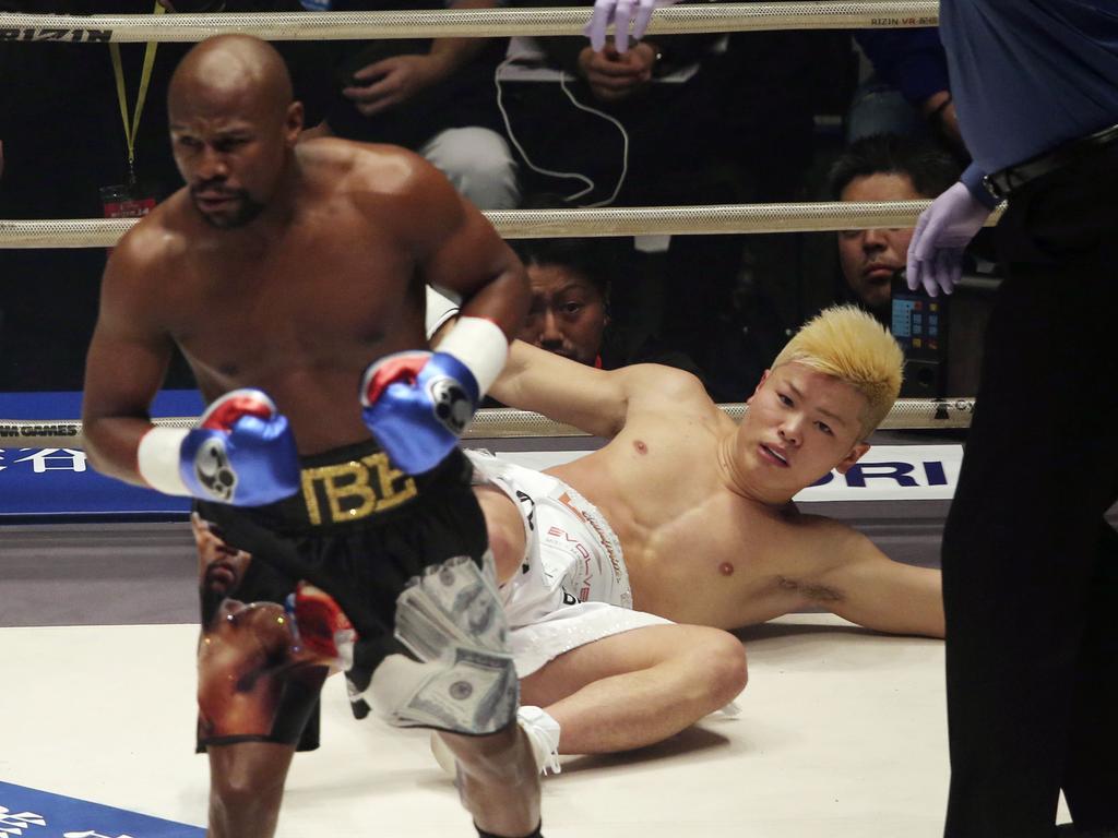 Japanese kickboxer Tenshin Nasukawa lies on the mat after being knocked out by Floyd Mayweather Jr. during first round of their three-round exhibition match on New Year's Eve, at Saitama Super Arena in Saitama, north of Tokyo, Monday, Dec. 31, 2018. (AP Photo/Koji Sasahara)